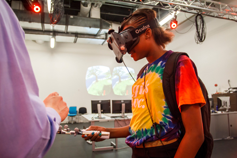 A student experiences virtual reality